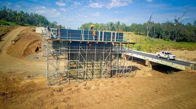 Work is powering ahead on the replacement of Cherwell Creek bridge after delays caused by Cyclone Debbie.