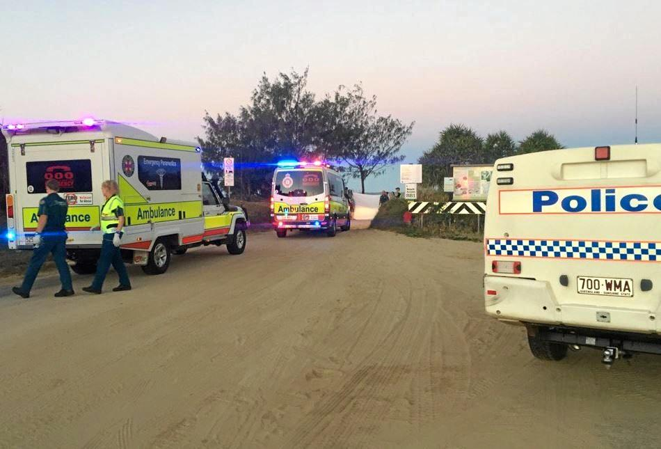 QAS officers at Bangalee where a man suffered serious head injuries this evening.