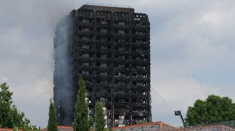 Smoke billows from Grenfell Tower as firefighters attempt to control a huge blaze on June 14, 2017 in west London. The massive fire ripped through the 24-storey apartment block in west London in the early hours of Wednesday,