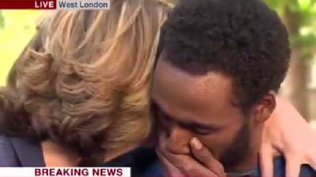 BBC host Victoria Derbyshire embraces London fire survivor Mahad Egal as he breaks down describing 'horrific scenes' of the Grenfell Tower blaze. Picture: BBC
