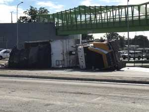 VIDEO: Truck driver rushed to hospital after rollover