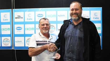 Dave Cameron from Qld Water, right, with QLD Operator of the Year (Civil All Rounder) Glenn Cook, left, from Gladstone Regional Council at the 2017 Water of Origin Competition.