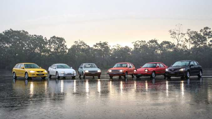LOOKING BACK: Generations of the Mazda 323/ Mazda3 gather at Mt Cotton, Brisbane, to celebrate the model's 40th anniversary in Australia. The weather wasn't kind, meaning the models' handling abilities were tested to the extreme