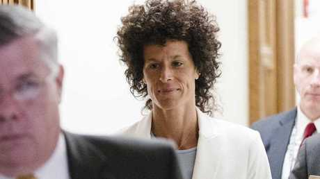 Andrea Constand walks from the courtroom during Bill Cosby's sexual assault trial at the Montgomery County Courthouse in Norristown, Pa., Tuesday, June 13, 2017. Cosby is accused of drugging and sexually assaulting Constand at his home outside Philadelphia in 2004.