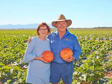 Paula and Des Chapman of Rocky Ponds with Kabocha pumpkins