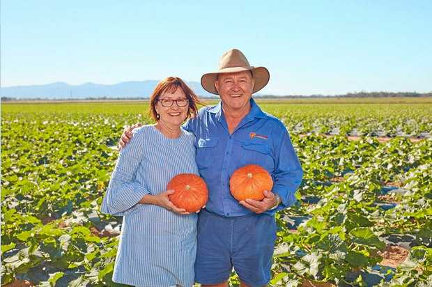 Paula and Des Chapman of Rocky Ponds with Kabocha pumpkins