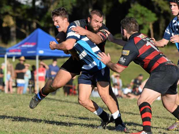 VITAL COG: SCU Marlins flyhalf Damon Rootes tries to get past a couple of Coffs Snappers defenders.