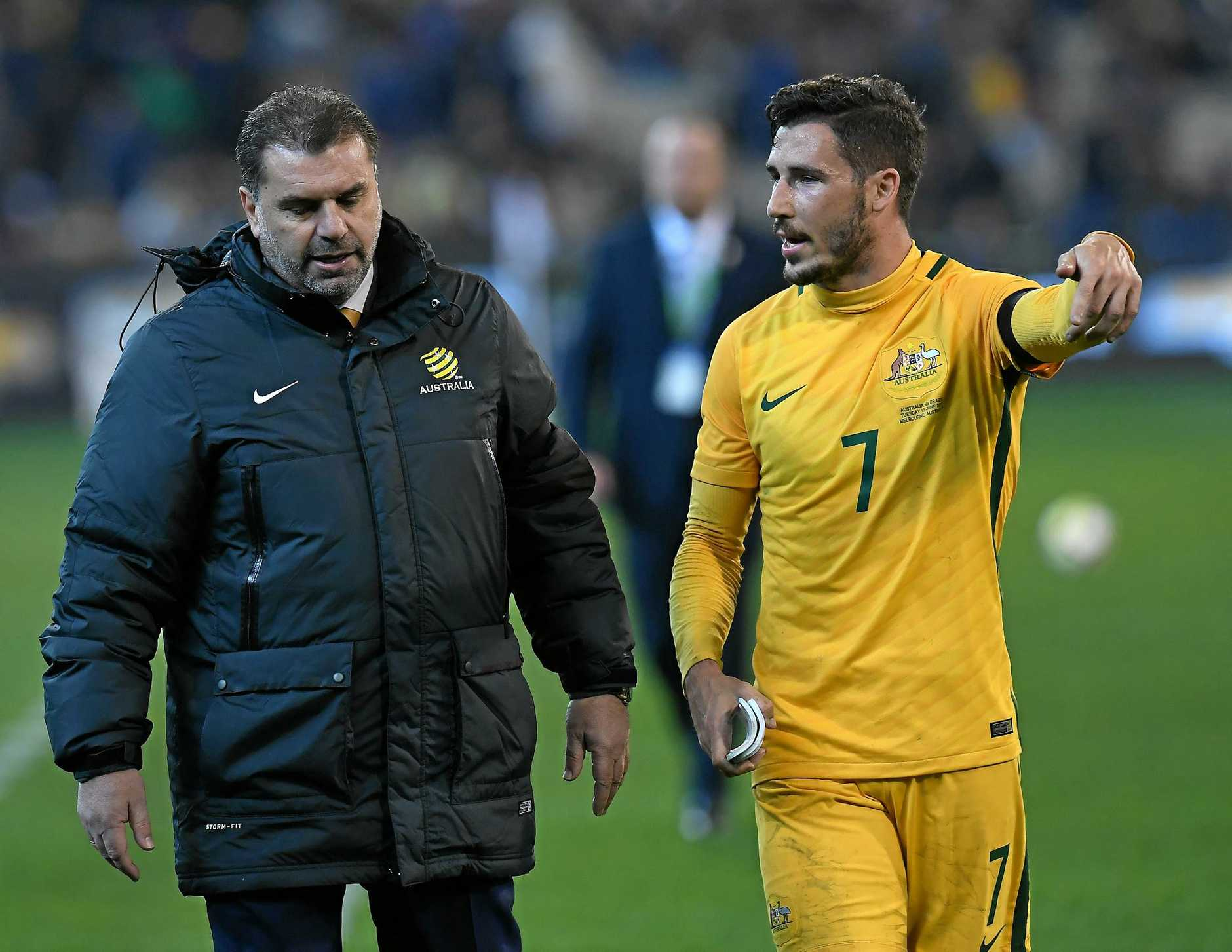 WORDS OF WISDOM: Mathew Leckie chats with Socceroos coach Ange Postecoglou.