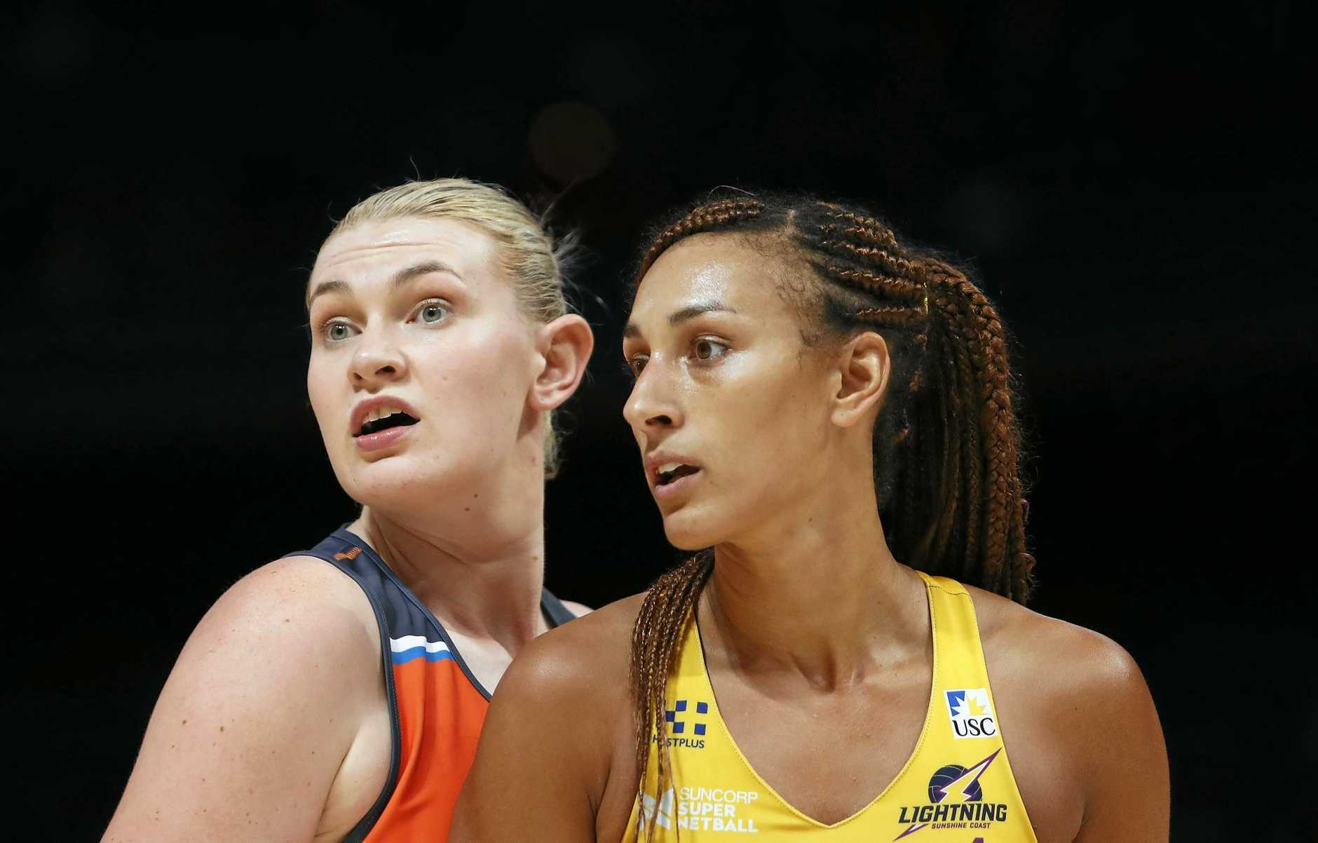 OPPONENTS: Giants shooter Kristina Brice and Lightning Geva Mentor during their last encounter at Sydney Olympic Park.