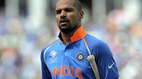 India's Shikhar Dhawan leaves the field after being bowled out by Bangladesh's Mashrafe Mortaza.