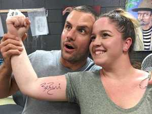 Mega footy star takes Mackay fan to get signature inked