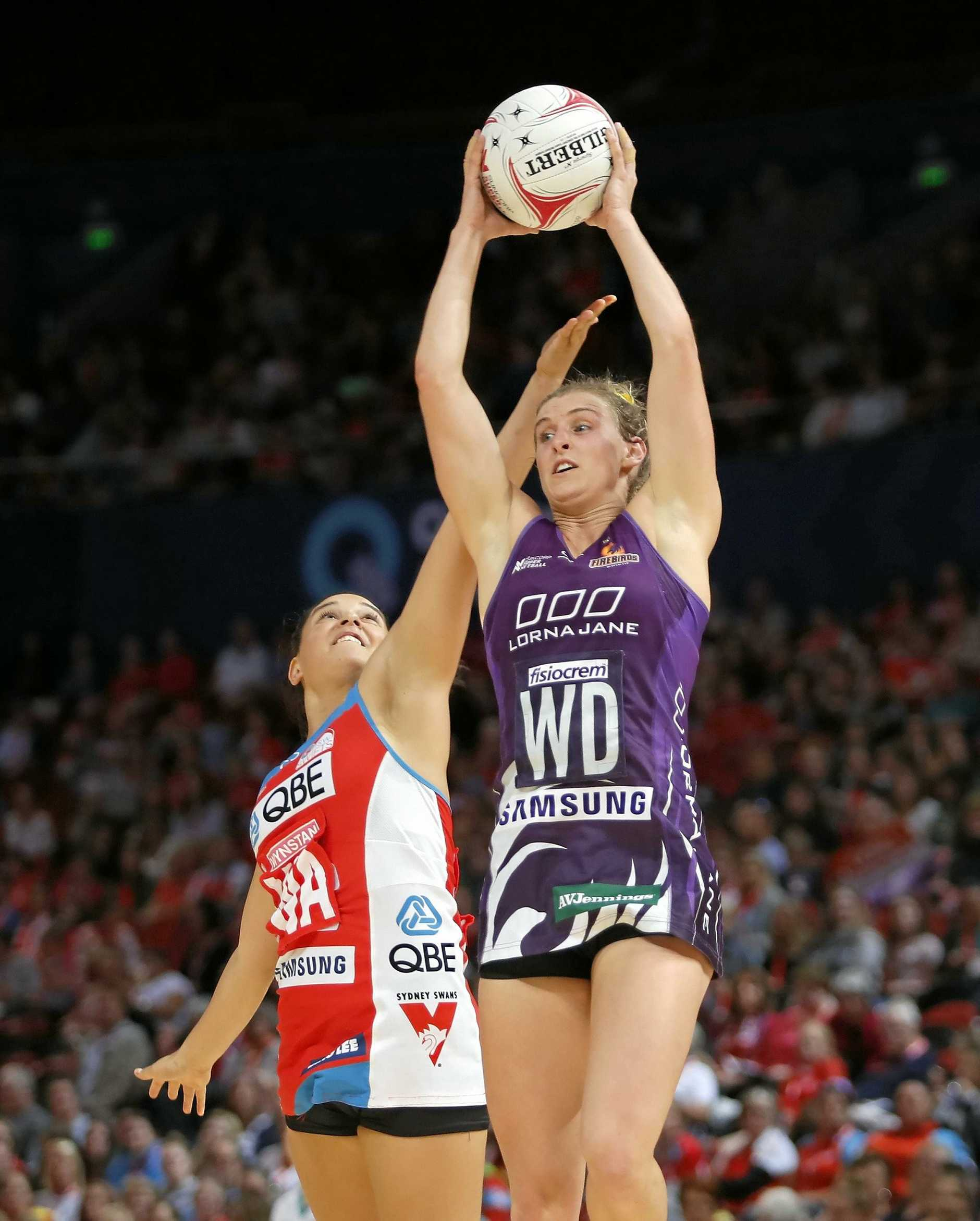 Firebirds skipper Gabi Simpson evades Swifts player Claire O'Brien.