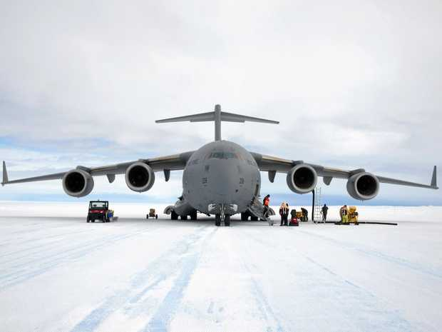 Unloading cargo from C-17A Globemaster III on Wilkins Runway.