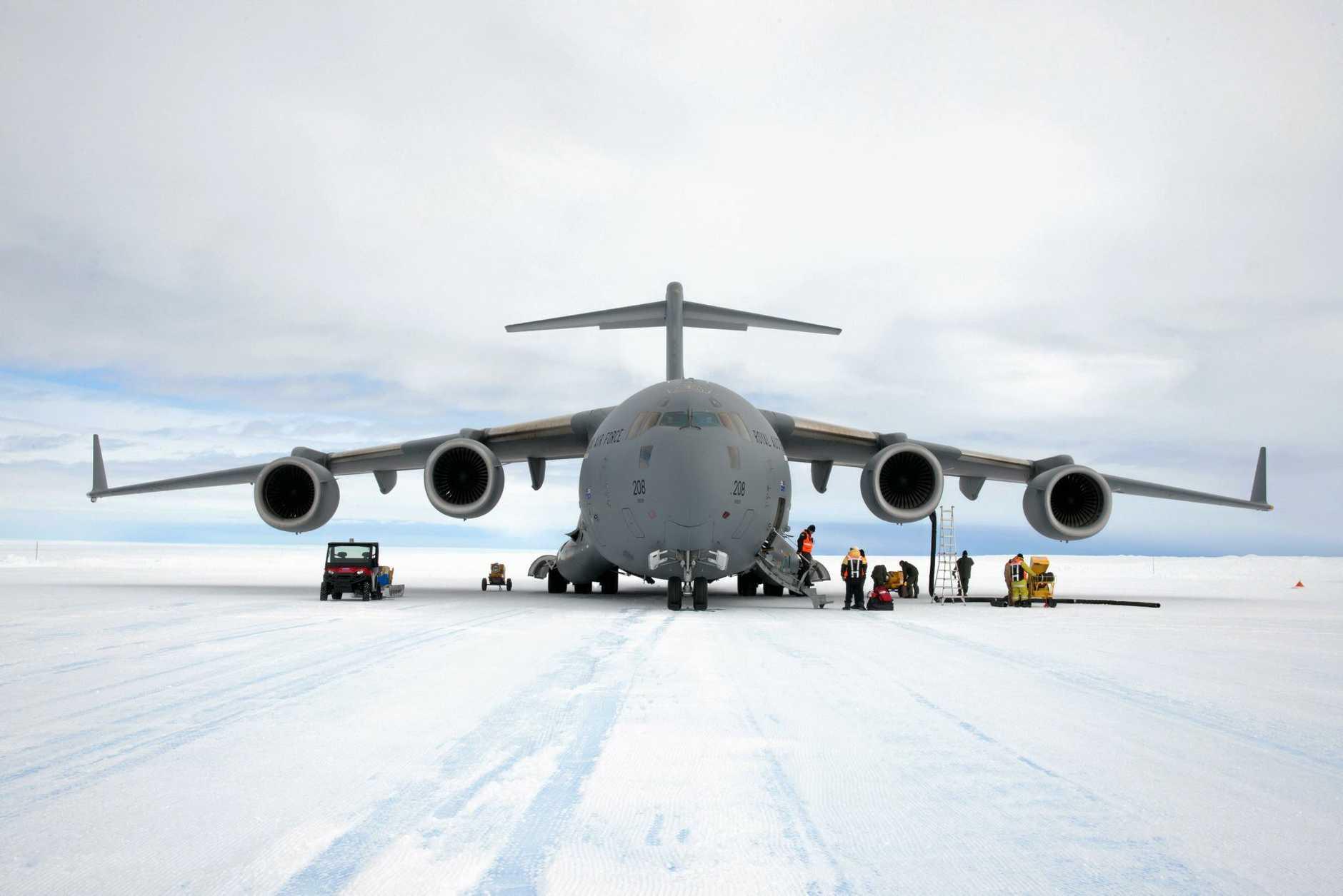 Unloading cargo from C-17A Globemaster III on Wilkins Runway.