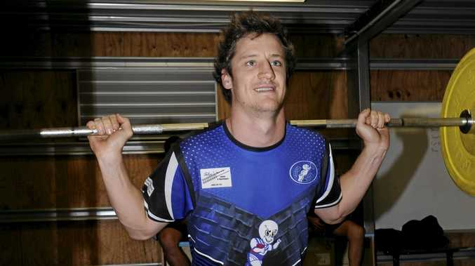 IRON MAN: Grafton Ghosts fullback Mitch Lollback puts in work in the weights room after training was forced from the field this week.
