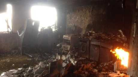 The charred remains of a kitchen inside the London apartment tower.