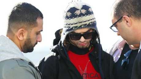Moudasser Taleb, 22, is arrested at Sydney airport today.
