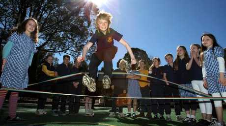 Redhill Primary jumping over elastics.Source:News Limited