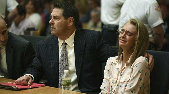 Michelle Carter, right, seated with her attorneys Cory Madera, left, and Joseph Cataldo reacts as she listens to Judge Lawrence Moniz before he finds her guilty of involuntary manslaughter in the suicide of Conrad Roy III, Friday, June 16, 2017, in Bristol Juvenile Court in Taunton, Mass.