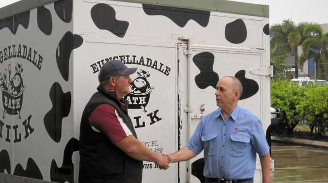 Eungelladale dairy owner Dale Forstecue with Terry Dennis, who donated to a crowdfunding campaign aimed at processing milk locally.