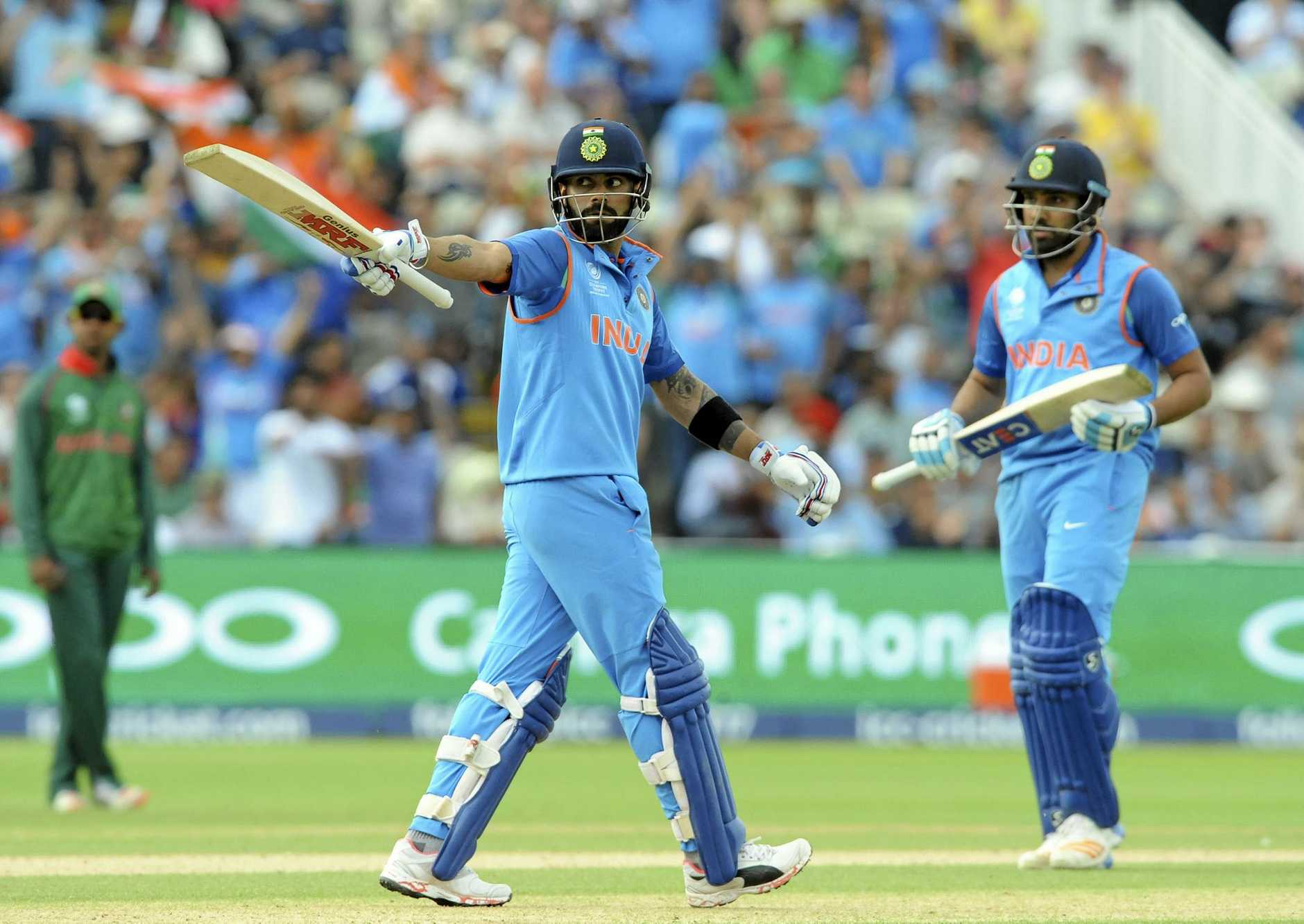India captain Virat Kohli marks a half-century in the ICC Champions Trophy semi-final against Bangladesh.