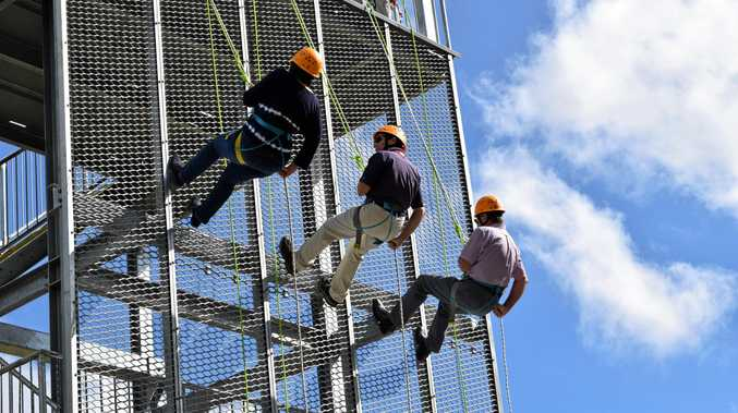 Member for Mackay Julieanne Gilbert, Scouts region commissioner Dougal McWhinney and Mackay Regional Council Mayor Greg Williamson test the new tower.