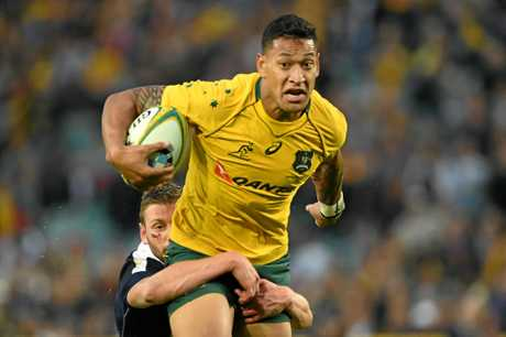 Israel Folau of Australia eyes the try line as he's tackled by Finn Russell of Scotland.