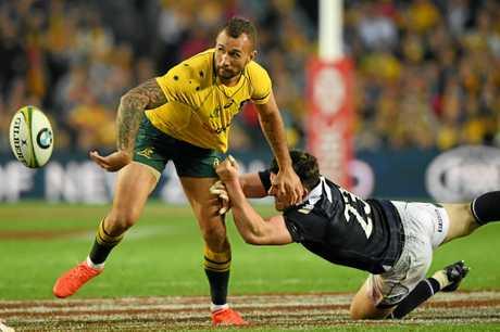 Quade Cooper of Australia gets a flick pass away.