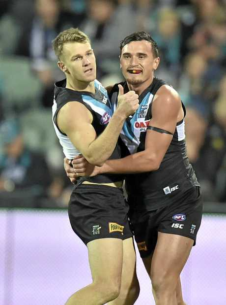 Robbie Gray and Sam Powell-Pepper of the Power celebrate a goal.