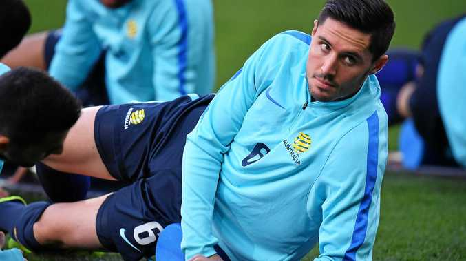Dylan McGowan of Australia stretches at a training session.