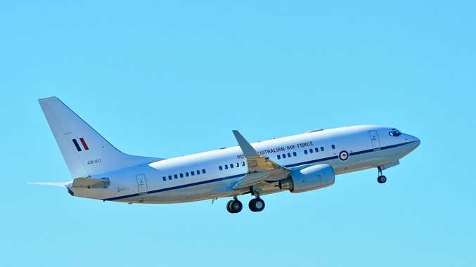 MYSTERY VISITS: The RAAF plane taking off from Gladstone airport around 3pm on Saturday.