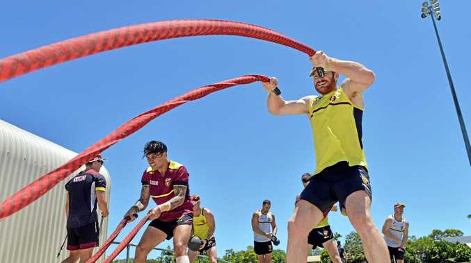 TRAINING: Daniel Merrett, right, works hard during a Brisbane Lions session last year. He's retired from the big stage but will play at least eight games for Caloundra this season.