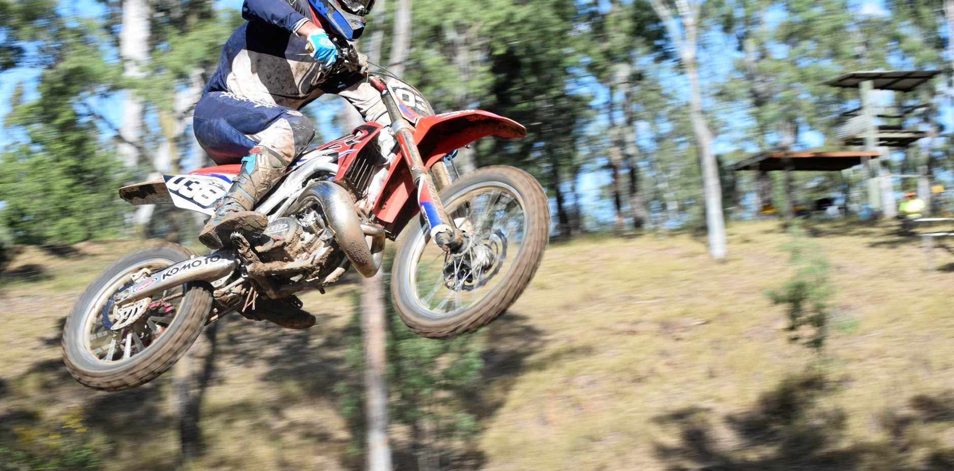 UP IN THE AIR: One of the riders successfully makes a huge jump at the MX track in Mundubbera.