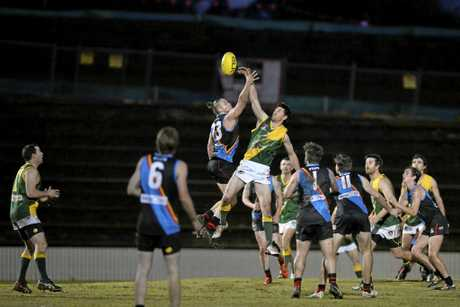 UP HIGH: South Toowoomba's Jonathan Leidig competes for the ball with Goondiwindi's Andrew Wynne at Heritage Oval on Saturday night.
