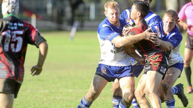 LOCKED UP: Grafton Ghosts front rowers Adam Slater and Riley Law combine in a strong effort to bring down Sawtell centre Jeelyn Kahu during the Group 2 first grade clash at Frank McGuren Field.
