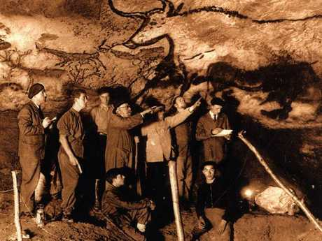 The real thing: Visitors to the genuine Lascaux cave which has been shut off from tourists since 1960 due to deterioration from carbon dioxide.