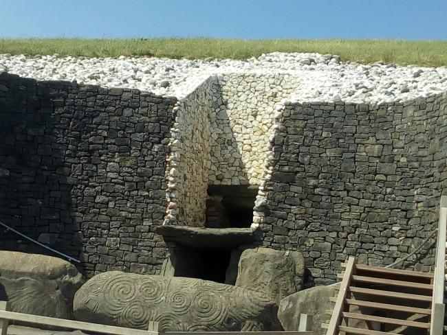 The entrance to Newgrange with its mysterious swirled stone carvings where the light illuminates its interior at precisely midwinter each year.