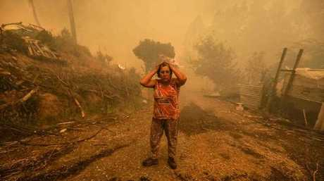 A woman reacts during a fire in Pampilhosa da Serra, central of Portugal, 18 June 2017.