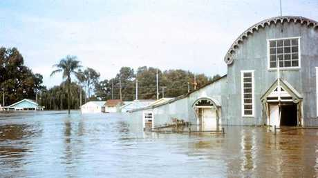 ABOVE: The Grafton Showground's Barn has seen a few floods in its lifetime.  Photo supplied: Rod Lee. RIGHT: A boy rides his horse in Prince St as a way of getting around the 1950 Grafton flood.  Photo: Newcorp Archives