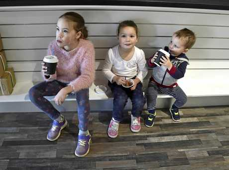 Smoko break, Ella, 8, (left) and Tayla, 5, and Peter, 2  take a break while helping their parents set up the new shop. Newsagent, newsextra will open in Margaret Street on Wednesday. June 2017