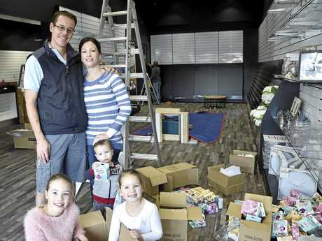 OPENING TOMORROW: news extra Central City owners Trent and Lindal Donovan with their children (from left) Ella, 8, Tayla, 5, and Peter, 2, unpack the new-look Margaret St store.