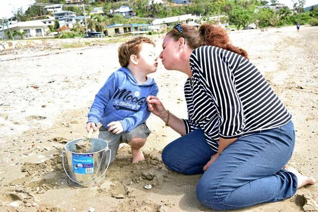 LASTING MEMORIES: Braxton Stanborough and mum Caroline Gouge share a special moment at Cannonvale Beach.