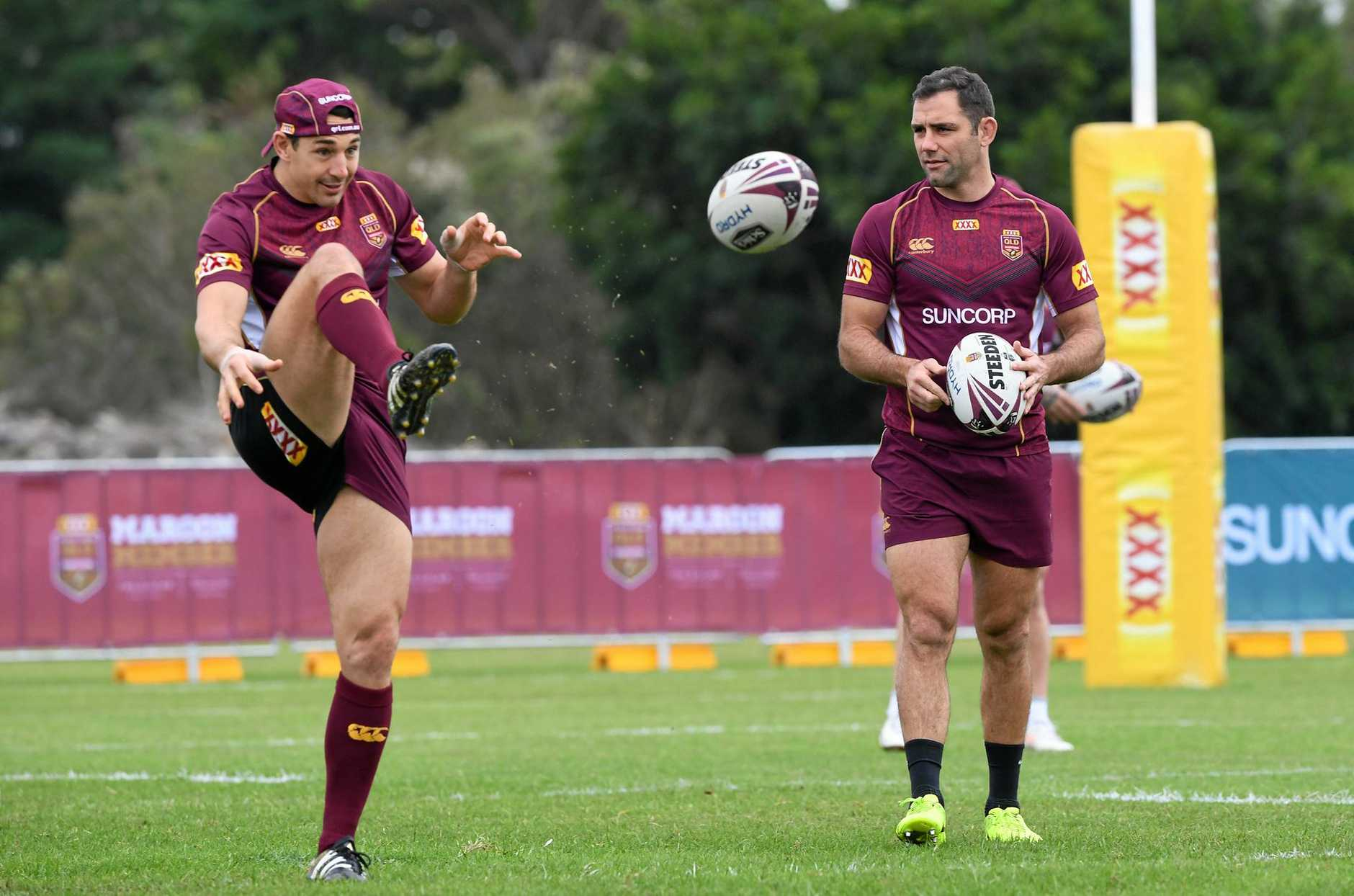 Billy Slater (left) and Cameron Smith during the Queensland State of Origin team training session on the Gold Coast, Friday, June 16, 2017. (AAP Image/Dave Hunt) NO ARCHIVING