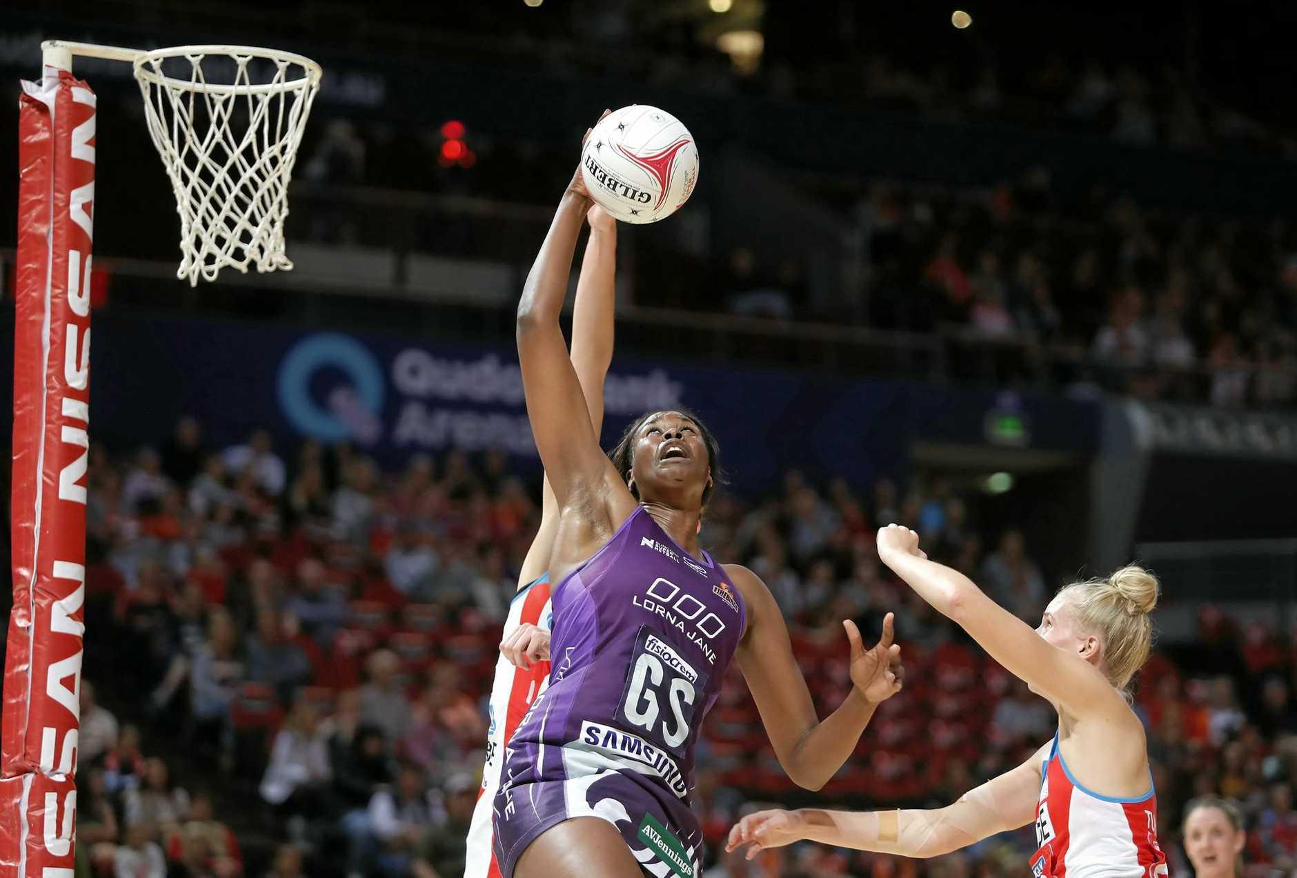 Shooting star Romelda Aiken has re-signed with the Queensland Firebirds.