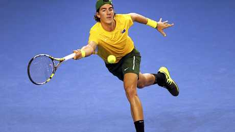 Australia's Thanasi Kokkinakis faces a tough task in the first round at Queen's up against Milos Raonic.