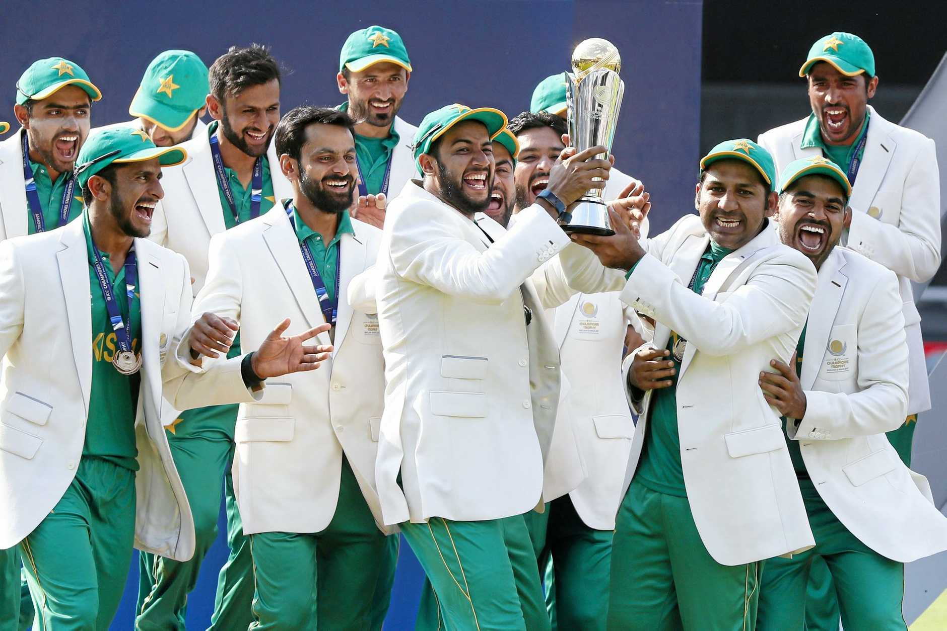 Pakistan players celebrate winning the ICC Champions Trophy after crushing India by 180 runs in the final.