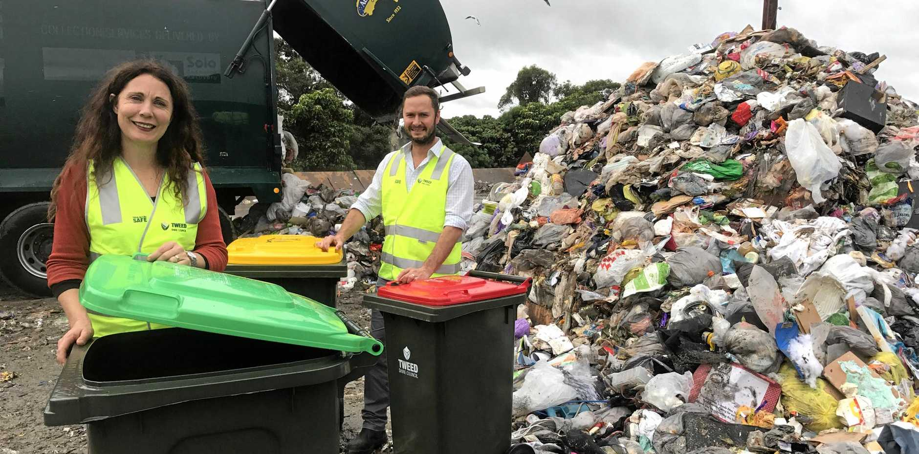 Tweed Shire Council's deputy mayor Chris Cherry and waste operations officer Wes Knight are hoping the new three bin waste system will reduce the mounds of waste in the shire.