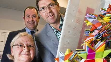 STARRY EYED: With some of the 25,000 stars made in the Darling Downs to end violence are (from left) Grand Central centre manager Shaine Beveridge, Cr Geoff McDonald and Sue Vaughan from Star Weave Fairies.