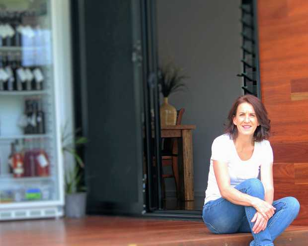 HEALTHY ON THE INSIDE: HOTI Kombucha founder Helen Tricarico at home with a fridge full of the fermented fizzy drink.