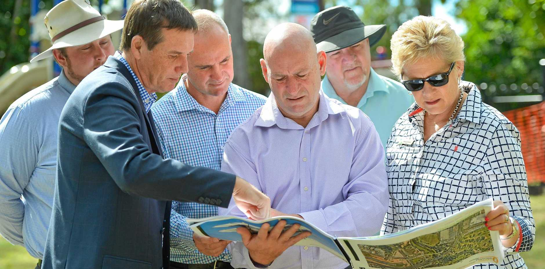 Gladstone MP Glenn Butcher and Minister for State Development Anthony Lynham announce $6 million for Gladstone projects as part of the Works for Queensland program. Pictured with deputy mayor Chris Trevor and councillors Desley O'Gradey, Rick Hansen and Kahn Goodluck.